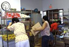 Volunteers Place Food Staples on Shelves