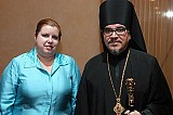 Bishop Alejo at AAC Banquet with Interpreter