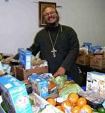 Fr. Antonio Sorting Food Boxes