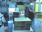 Retiree Volunteer Unpacks & Refrigerates Cold Food