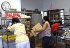 Volunteers Place Food Staples on Shelves